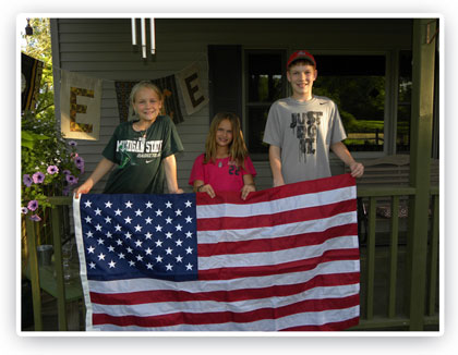 Luttig children with flag flown over our nations capital in Curt's honor.
